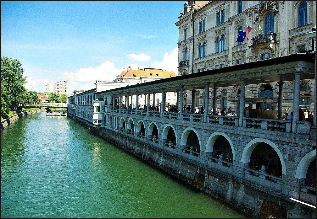 Arches by the river at Triple Bridge Ljubljana Slovenia