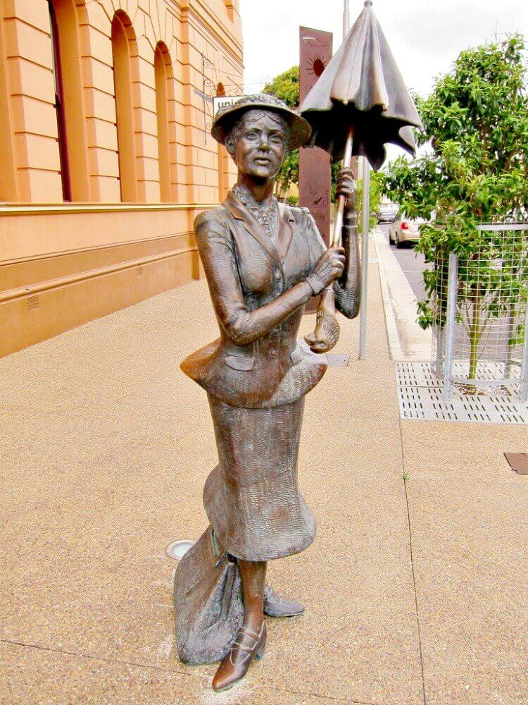Bronze Statue ofMary Poppins on the footpath in Maryborough Queensland