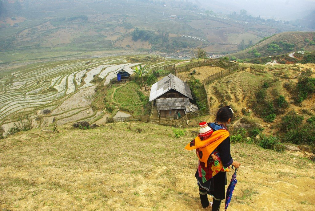 Hmong mother and child take a break whilst trekking