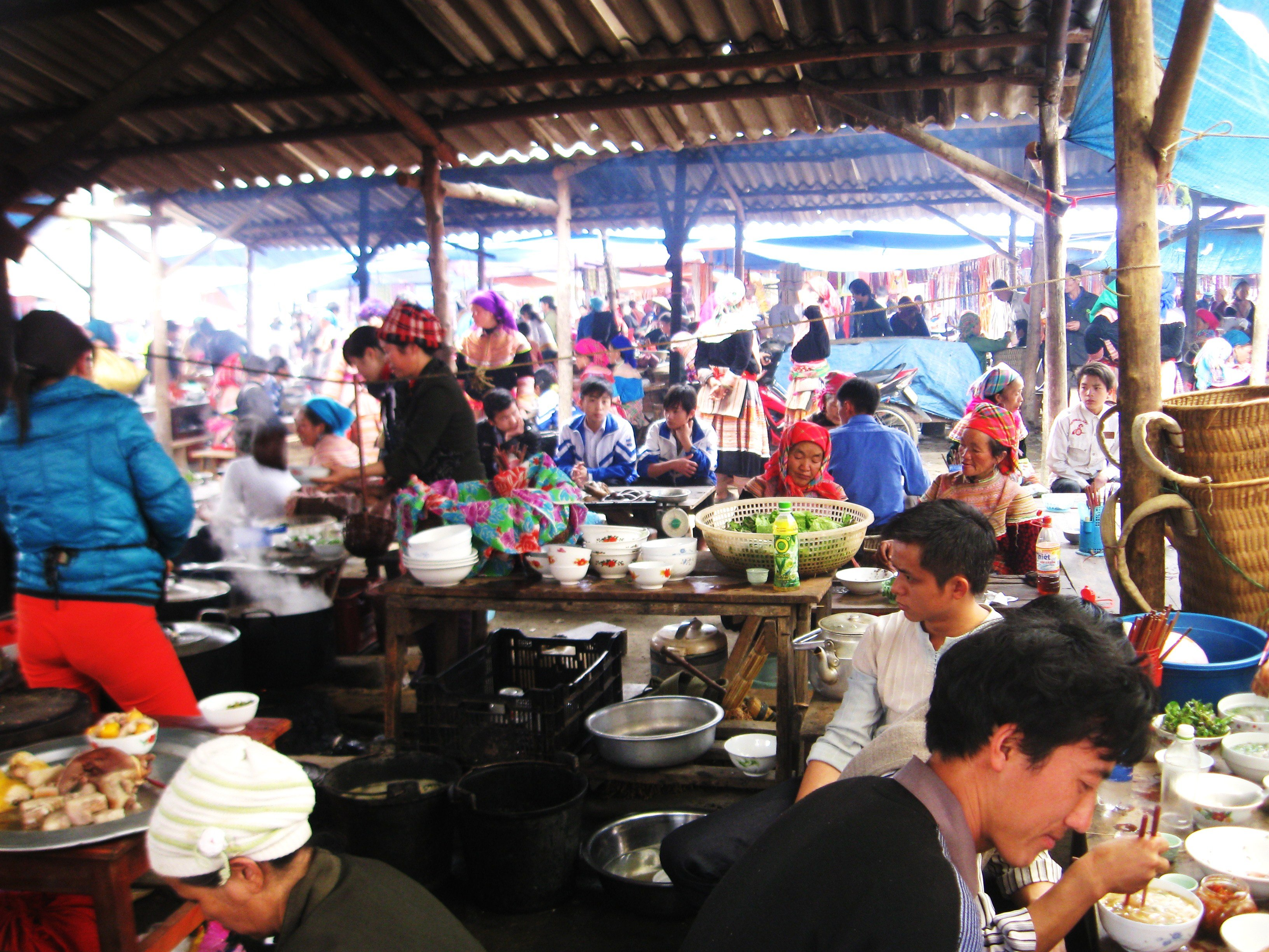 Locals catch up with each other in the eating area at the weekly market at Bac Ha