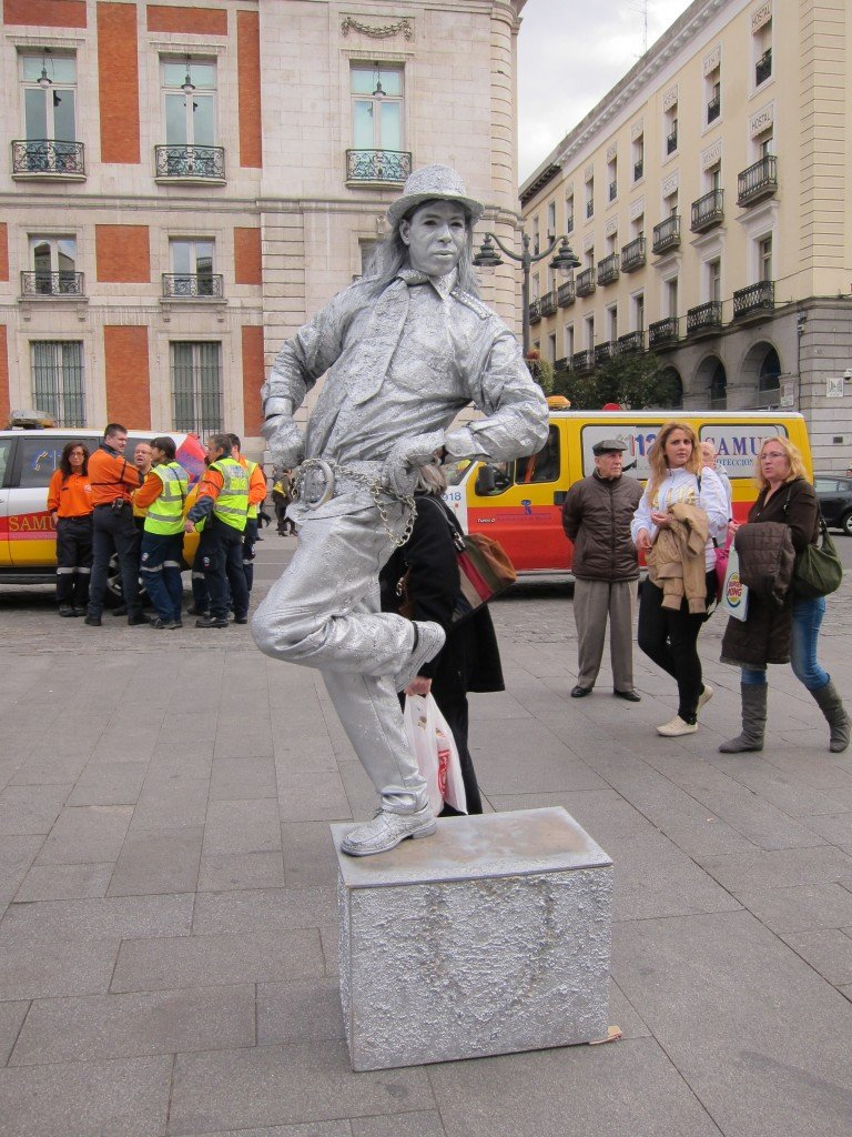 Silver human statue in the streets of Madrid