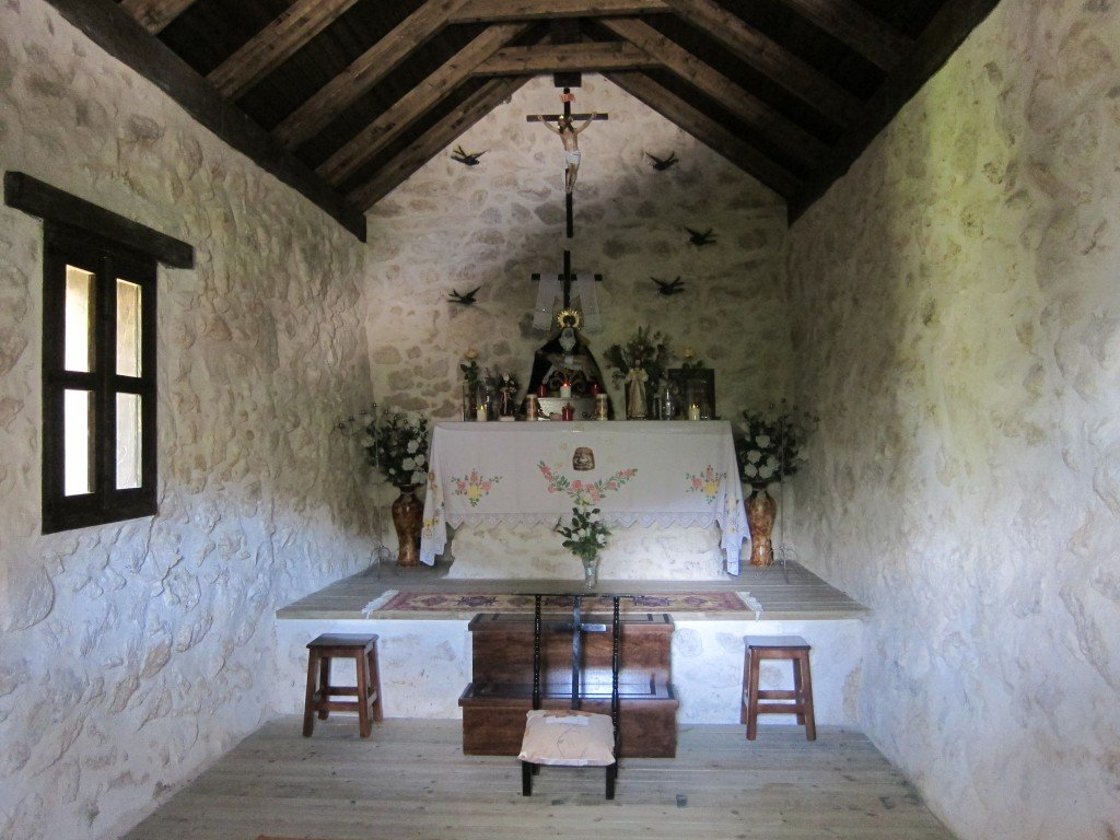 The path led to a little chapel, with a flap in the door, through which I took this photo