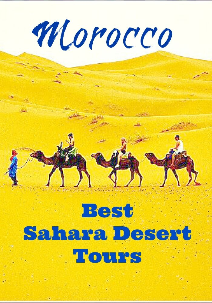Yellow Sand of the Sahara with three brown camels being led by a Berber Camel Guide in Blue for Best Sahara Desert Tours