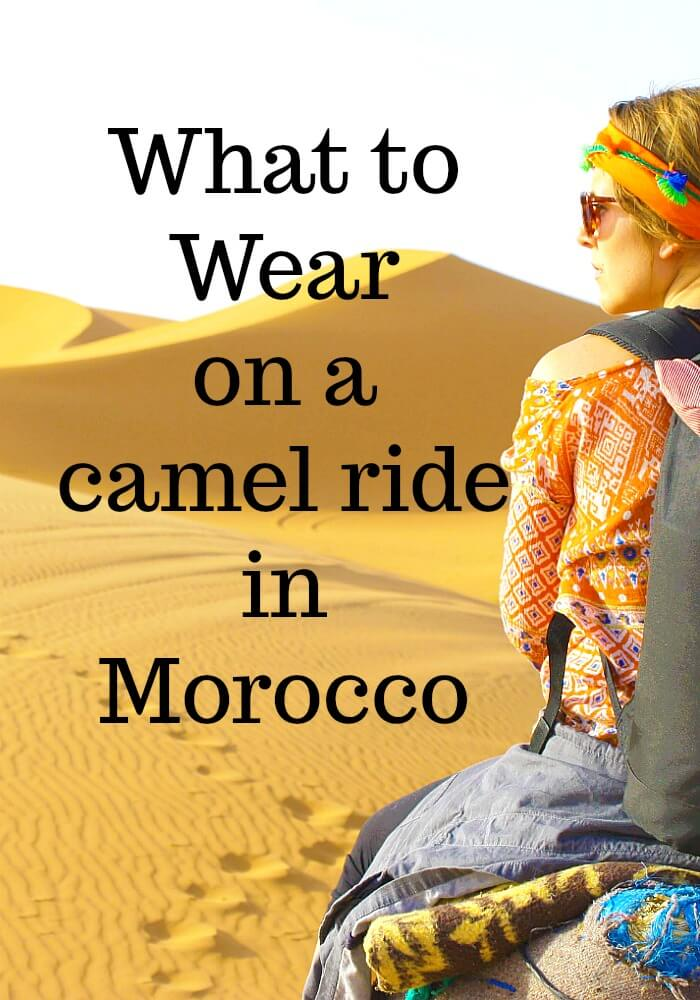 Back view of a girl on a camel in the Sahara. Camel prints are embedded in the sand and the words What to Wear on a camel ride in Morocco