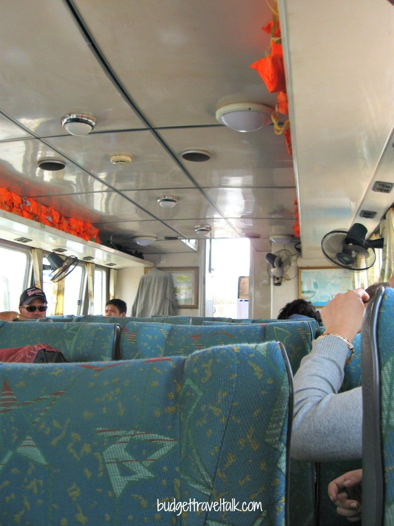 """Fans and fresh air inside the """"speed boat"""" that took us to Cat Ba Island."""