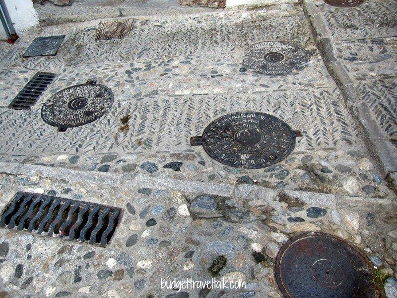 Manholes in the Albaicin area of Granada, Spain