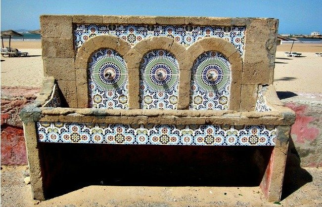 A traditionally tiled drinking fountain at Essaouira Beach Morocco