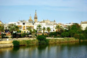 Guadalquivir River, Giralda Tower and Cathedral over rooftops