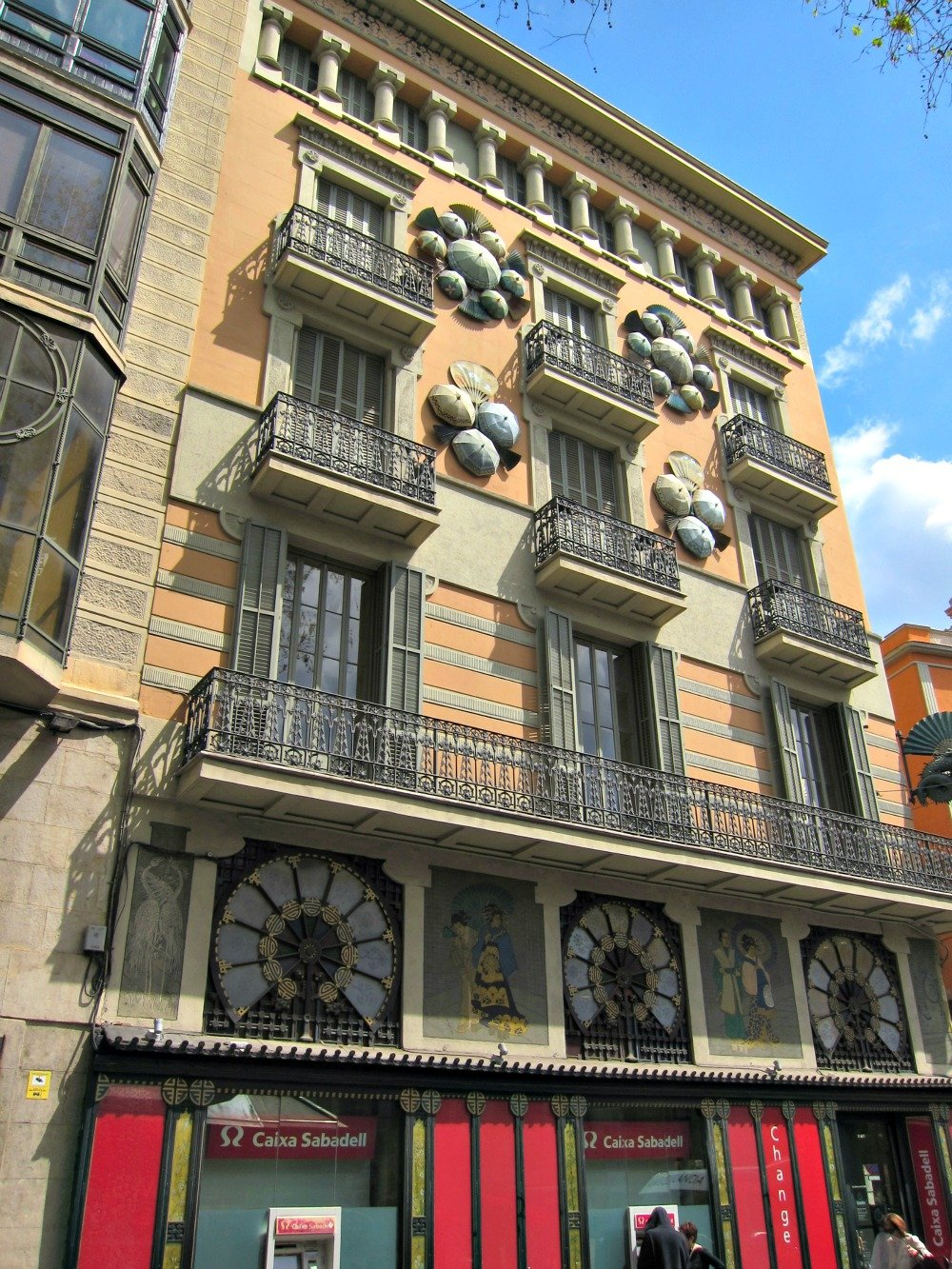 Decorative Buildings in Barcelona.  This one has round semi-circular additions.