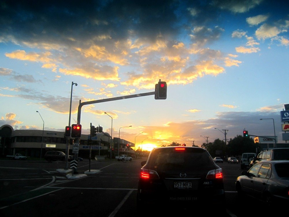 Traffic Lights and the sinking sun at 6.17 p.m.