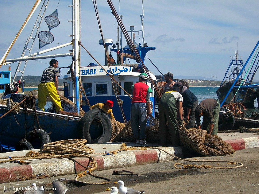 Fishermen haul the nets in the port of Essaouira Morocco