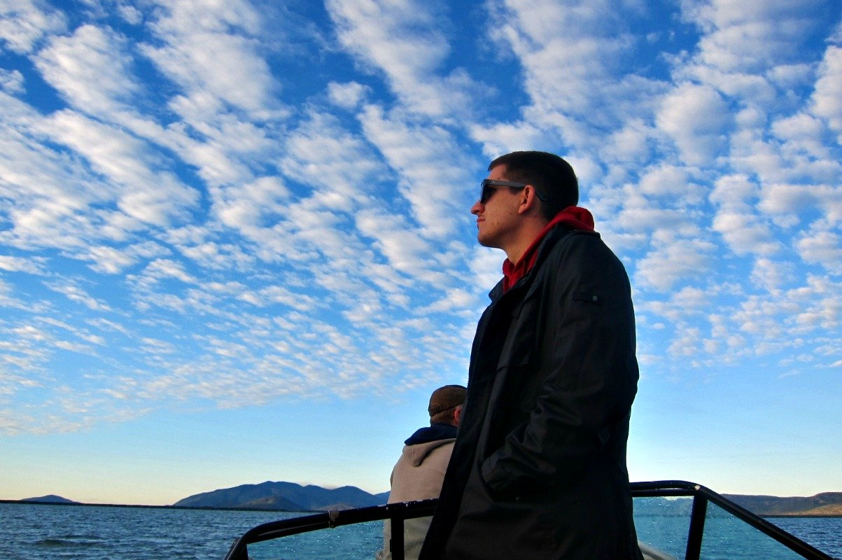 dBudget Son surveying the clouds from our boat anchhored in Cleveland Bay