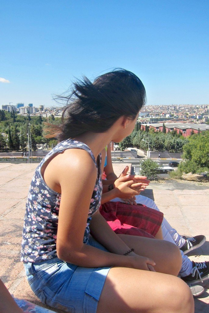 Sitting with the kids on top of the wall in Istanbul