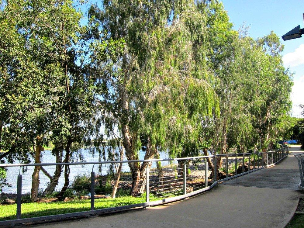 Walkway between Itara Apartments and River