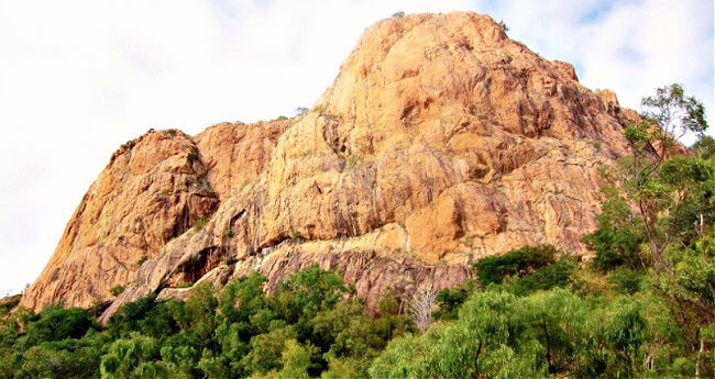 Looking up to the rock face of Castle Hill Townsville from the Castle Hill Goat Track