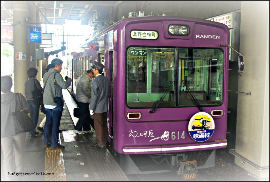 Photo of the cute purple box shaped engine/carriage on the Randen Tram Line in Kyoto