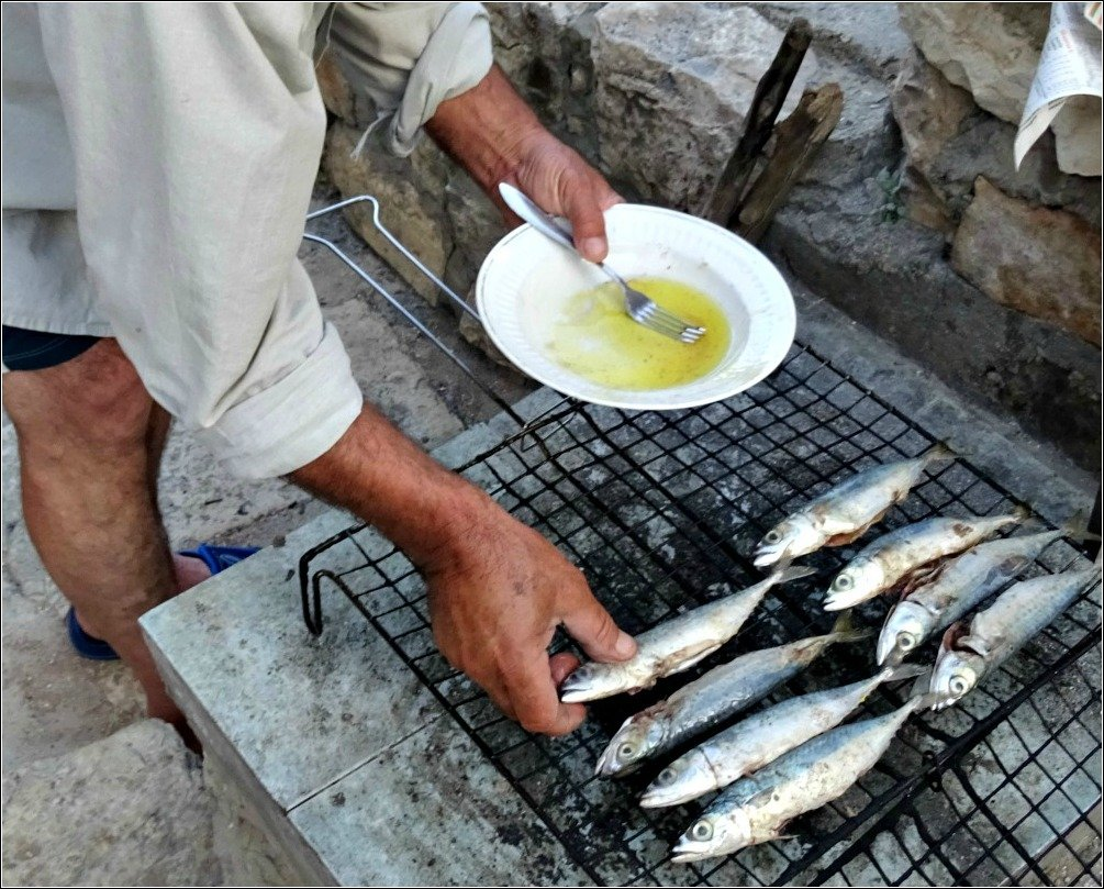 Adding Fish to the Grill Vis Island Croatia