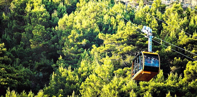 Dubrovnik Cable Car with green trees of Mt. Srd in the background