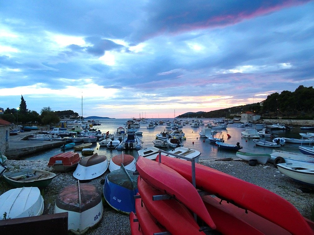 Sunset over the small boat harbour on Put Križa Hvar Town
