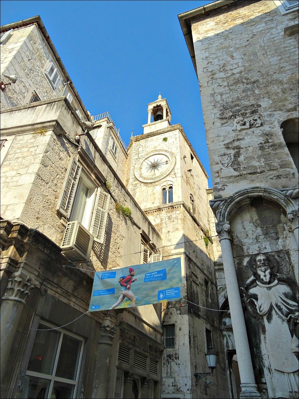 Diocletians Palace Clock Tower and Advertisement