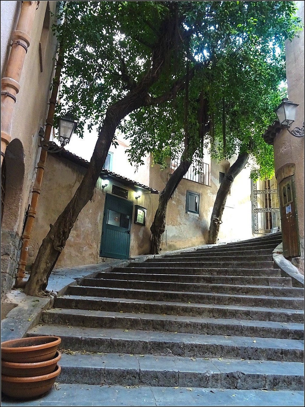 Curved staircase leads to Lavatoio in Cefalu, Sicily