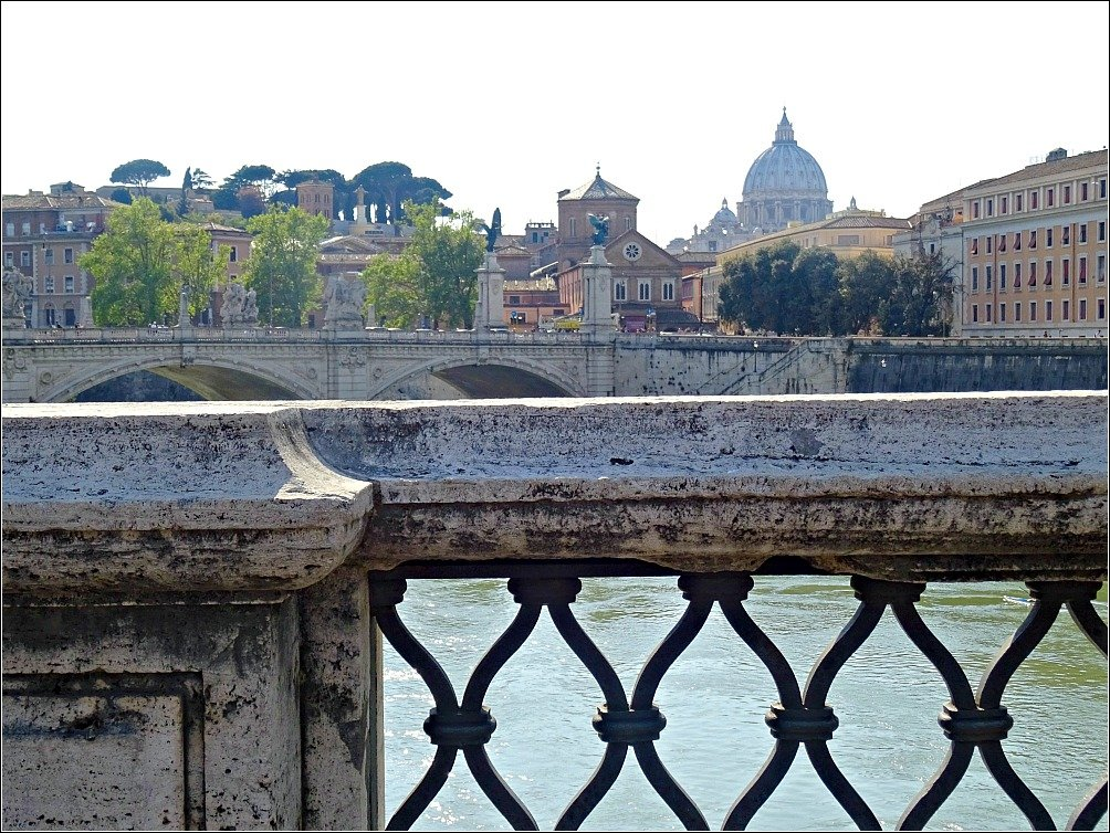 Pont Sant'angelo a famous bridge in Rome looks toward St. Peter's Rome