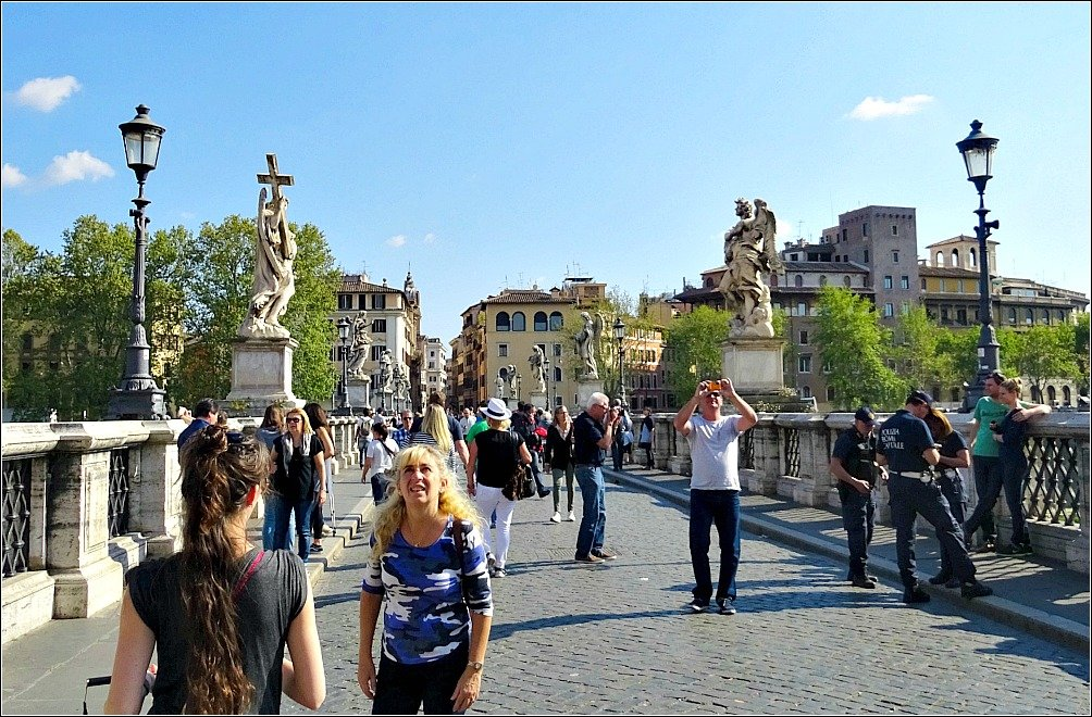 Ponte Sant' Angelo with Statues and Lamps as seen on a walk by the Tiber River Rome