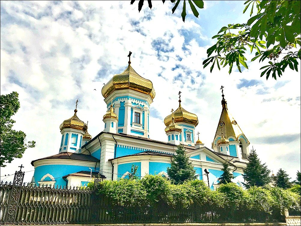 Photo of the blue and gold exterior of Ciuflea Monastery in Chisinau Moldova