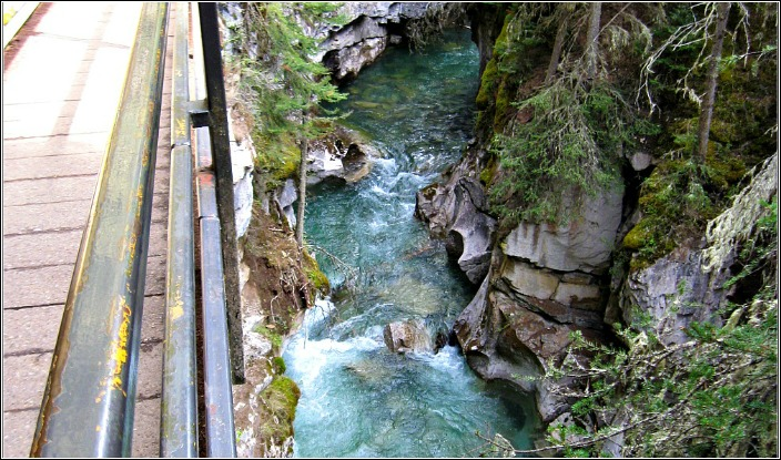 Johnston Canyon on the road from Banff to Lake Louise with pathway attached to canyon wall