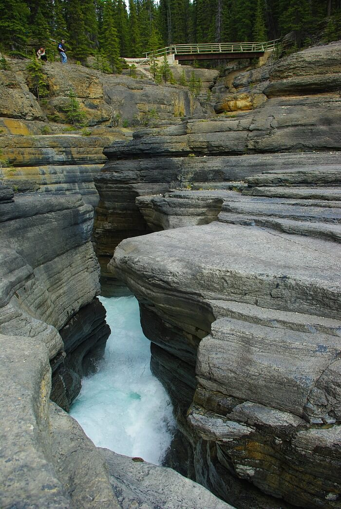 Mistaya Canyon on the Icefields Parkway in the Canadian Rockies is wavy rock formations formed by rushing water