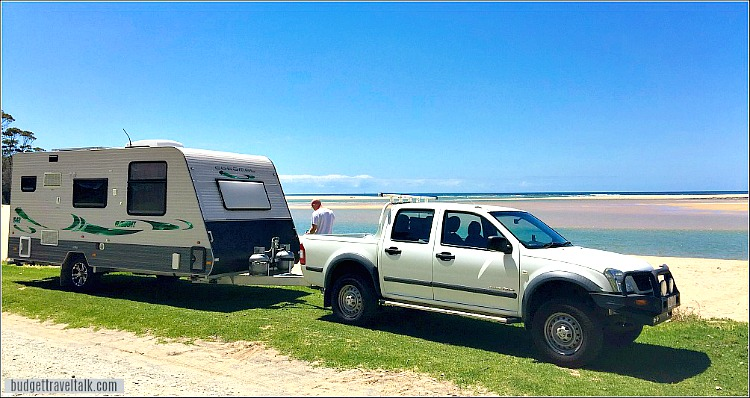 A Coromal Caravan and tow vehicle used for free camping parked by the ocean inlet at Durras North New South Wales Australia