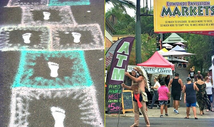 Footprints spray painted onto the pavement leading to the Pavillion Market at Eumundi Markets on the Sunshine Coast
