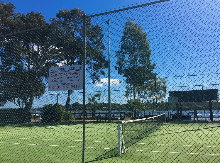 Fnced Grass Tennis Court on the banks of the Noosa River in Noosaville