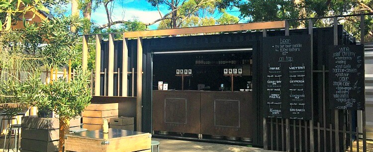 Outdoor Bar at Bruny Island Cheese with timber deck beneath the gum trees