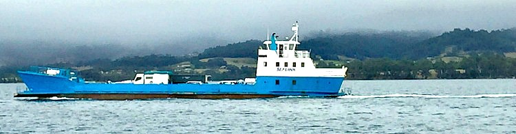 The Blue and White Moongalba Ferry with a stormy background Bruny Island