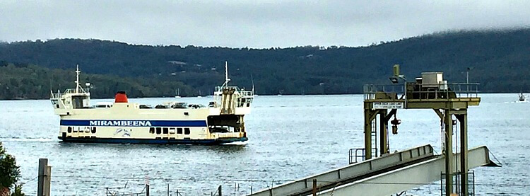 The white Mirambeena Ferry arriving at North Bruny on an overcast day