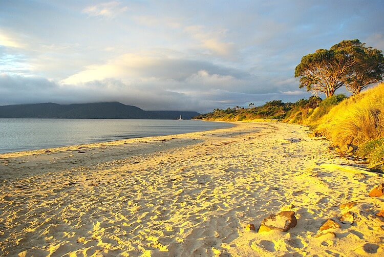 Bruny Island Sunset turning the sand on Alonnah Beach golden in Sunset Bay South Bruny