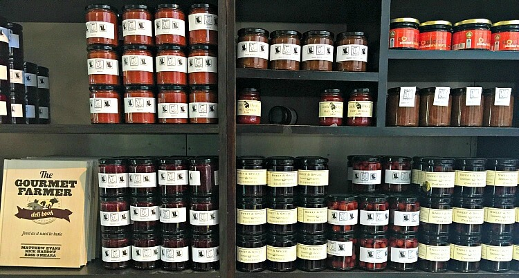 Bottles of Tasmanian Produce stacked attractively in shelves at Bruny Cheese