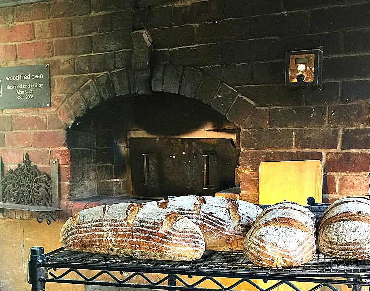 Wood Fired Oven with freshly baked bread on a rack at Bruny Island Cheese