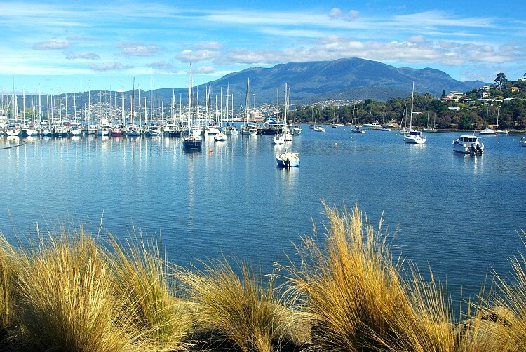 View across Bellerive Harbour with moored yachts to Mt Wellington