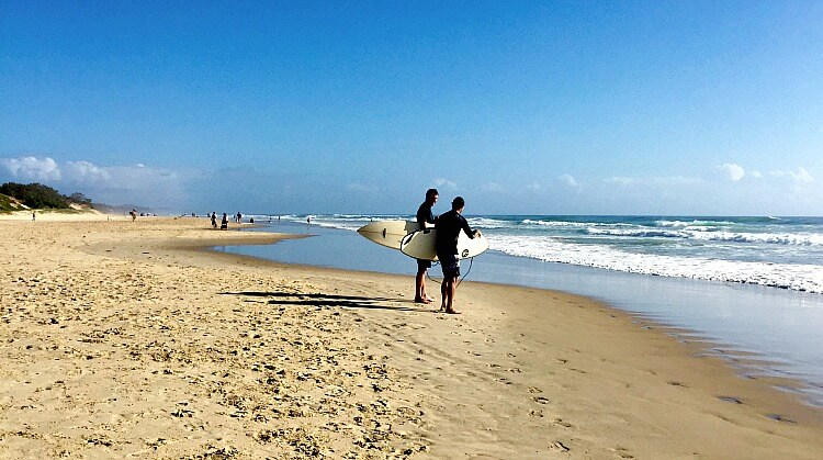 Two Surfers with boards at Coolum Beach