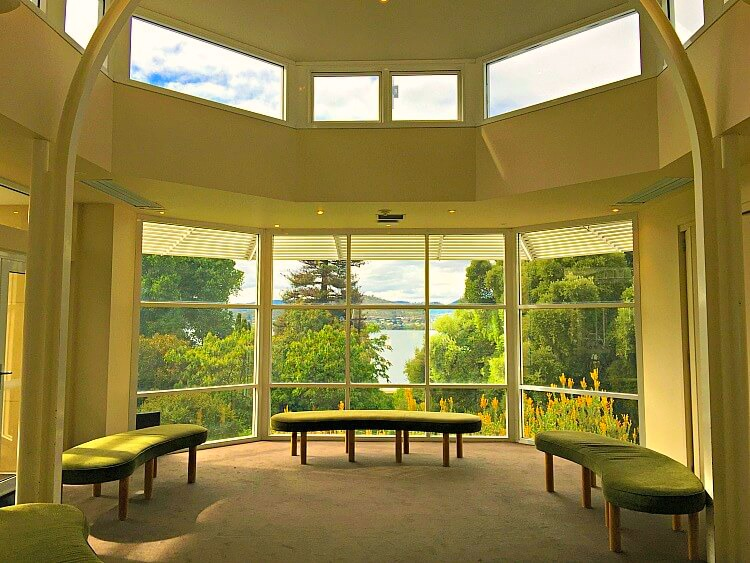 Looking through the windows of the Hobart Botanical Gardens Visitor Centre over the gardens to the Derwent River