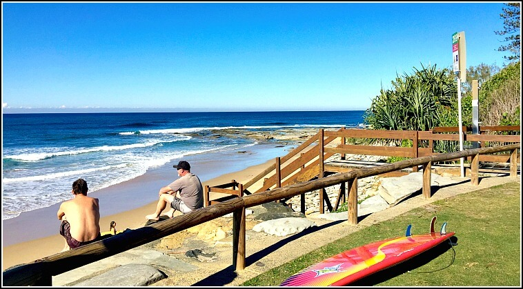 Surfers, Boards and Blue Skies at Dicky Beach