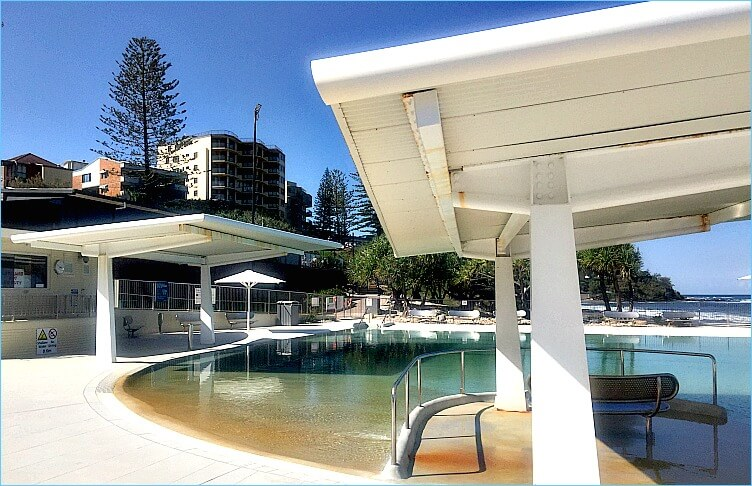Kings Beach Pool filled with sea water with shade structures
