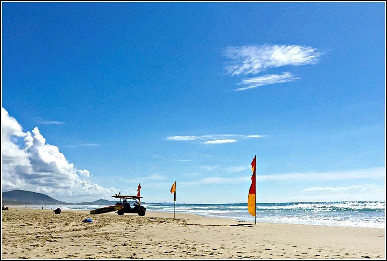 Mudjimba Beach with Surf Lifesaving Flags and Buggy