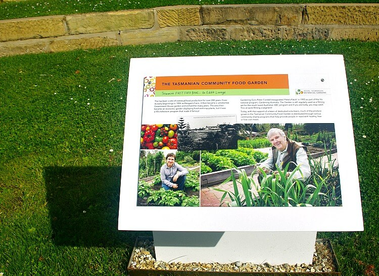 A plaque in the Tasmanian Food Garden tells about the role of the Gardening Australia use of the veggie patch