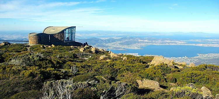 Glass and Stone Pinnacle Shelter with Native vegetation and view