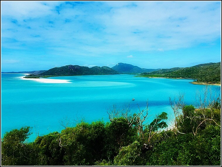 White sand and swirling blue patterns of Hill Inlet Whitsunday Island at high tide