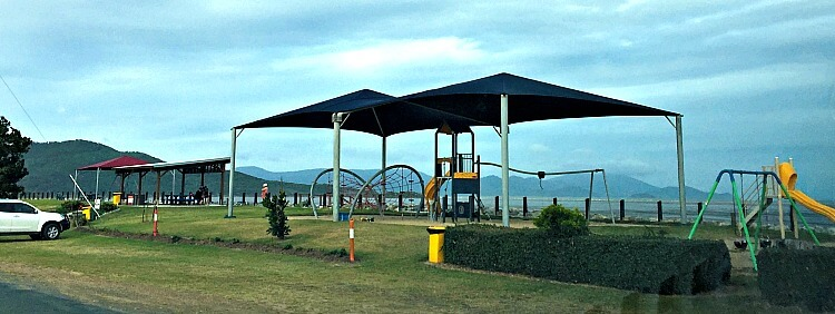Children's playground and undercover picnic tables and BBQ at Conway Beach near Airlie Beach