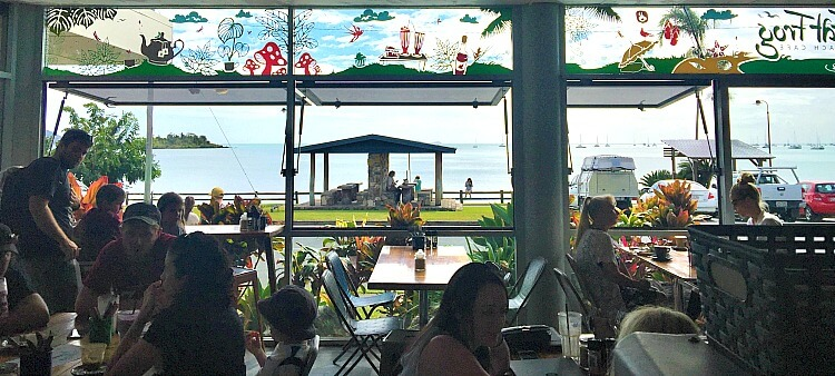View through the Fat Frog Cafe shopfront windows to the Coral Sea
